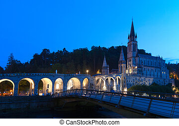 Basilica Lourdes - Rosary Basilica at night during the...