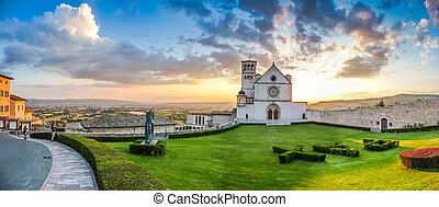 Basilica of St. Francis of Assisi at sunset, Umbria, Italy -...