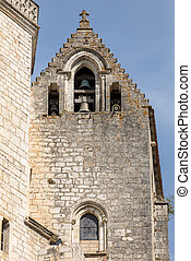 Basilica of St-Sauveur blend into the cliff in Rocamadour, France