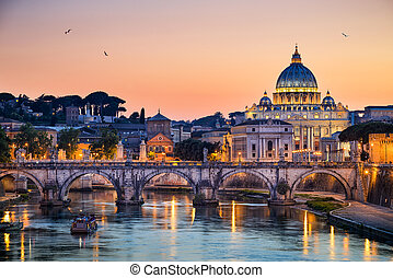 Night view of the Basilica St Peter and the Tiber river in Rome, Italy