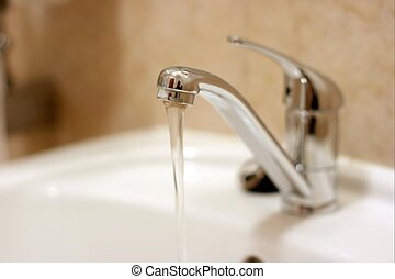 Water flowing from a tap in the bathroom