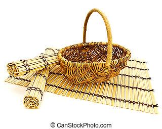 basket and bamboo mats