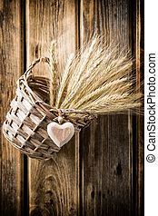Basket and rye. - On the walls hang wooden basket with rye. ...