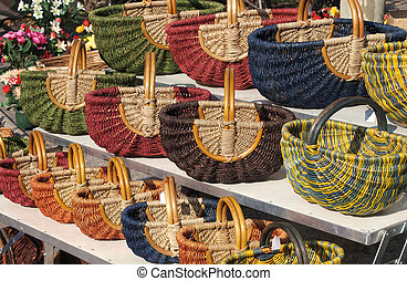 Basket at a market - a colorful display of baskets at a ...