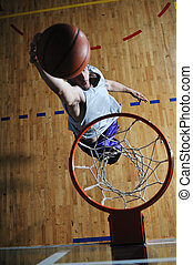 basket ball game player at sport hall - one healthy young ...