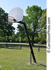 A basketball hoop in the country.