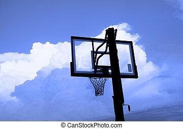 Basket ball hoop against cloudy blue sky