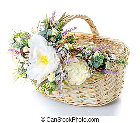 Basket decorated with flowers on white background