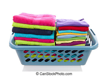 basket filled with colorful folded laundry over white ...