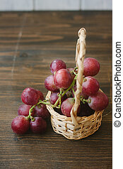 Basket filled with red grapes