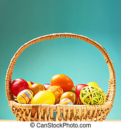 Basket full of colorful Easter eggs