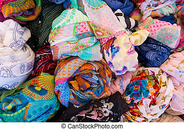Basket full of colorful women clothes.