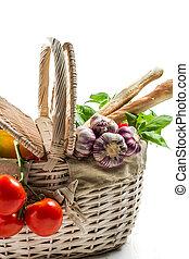 Basket full of fresh vegetables on white background