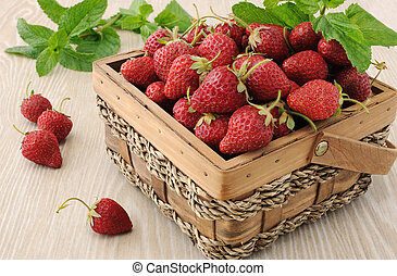 Basket full of strawberries on the table