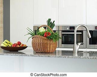 Basket full of vegetables in a modern kitchen.