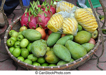 Basket full with exotic fruits in a market. Vietnam