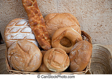 Basket of assorted bread rolls and bagels