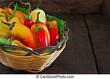 Basket of chillies on old wooden table