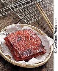 basket of chinese bakkwa - close up of a basket of chinese ...