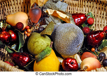 Basket of decorative fruit.