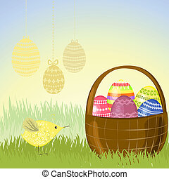 Basket of Easter eggs in the meadow
