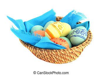 Basket of Easter eggs on white