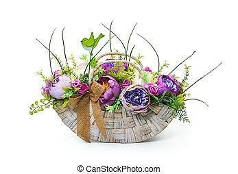 Basket of flower arrangement on white background