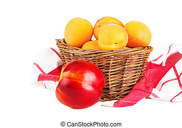 Basket of fresh apricot and nectarine isolated on a white