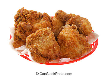 Basket of fried chicken - a red basket of fried chicken