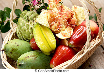 Basket of fruits - varieties of tropical fruits in bamboo...