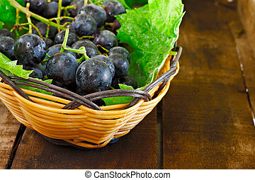 Basket of grapes on rustic wooden table