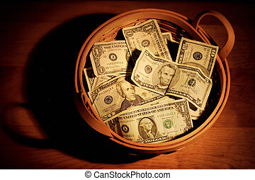 Basket of money - A basket full of money with very dramatic...
