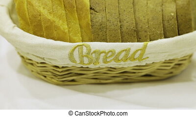 Basket of sliced ??bread and the word Bread