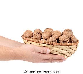 Basket of walnuts in hands.