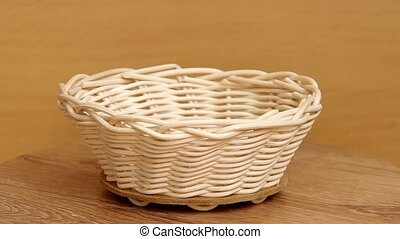Basket weaving from rattan  are rotated on the table.