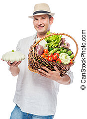 Basket with a harvest in the hands of an experienced farmer on a white background