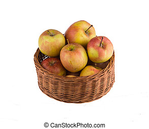 Basket with apples isolated on white background.