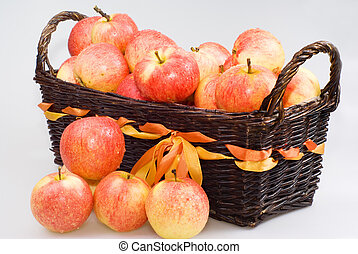Basket with apples on the white background