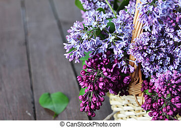 basket with  branch of lilac