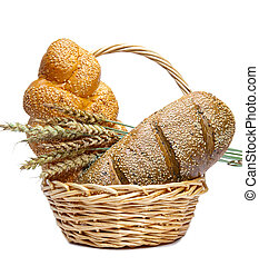 Basket with bread on white background