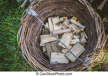 Basket with chopped wood - A wicker basket with chopped wood...