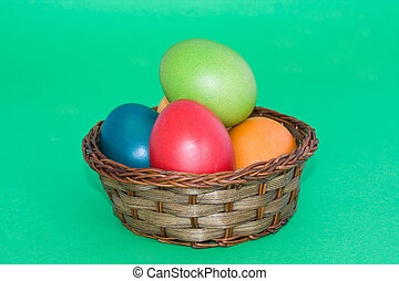 Basket With Easter Eggs Isolated On Green Background