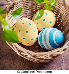 Basket with Easter eggs. Close up.