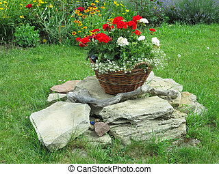 basket with flowers on a background of nature in countryside