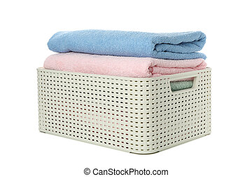 Basket with folded towels isolated on white background