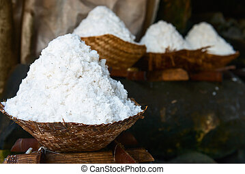 Basket with fresh extracted sea salt in Bali, Indonesia -...