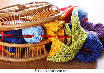 Wooden basket with multi color knitting. Close up