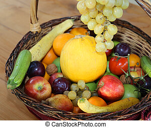 basket with lots of fresh fruit in autumn and winter season