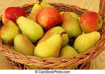 Basket with pears and apples - Basketwork bin filled with...