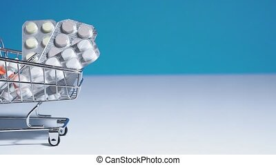 Basket with pills on a blue background. The concept of retail medicine. Buying tablets